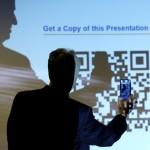 Jon Pappas picking up a copy of the presentation